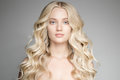 Beautiful Young Blond Woman With Long Wavy Hair. Royalty Free Stock Photo