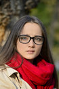 Beautiful young blond woman and a tense look with glasses in her eyes Royalty Free Stock Photos