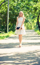 Beautiful young blond woman in a white dress outdoors Royalty Free Stock Photography