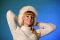 Beautiful young blond woman in a white fur hat Royalty Free Stock Photos