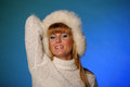 Beautiful young blond woman in a white fur hat Stock Image