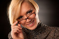 Beautiful young blonde with eyeglasses  Stock Photos
