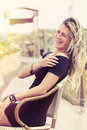 Beautiful young blonde girl laughing outdoor. Royalty Free Stock Photo