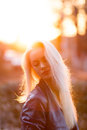 Beautiful young blonde girl with a pretty smiling face and beautiful eyes. A woman with long hair dispels their, amazing looks. Royalty Free Stock Photo
