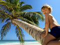 Beautiful young boy plays on a tropical beach Royalty Free Stock Images