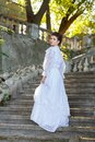 Beautiful young bride in wedding dress on the steps. Royalty Free Stock Photo