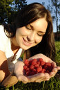 Beautiful young brunet girl holding raspberries Stock Images