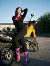 Beautiful young brunette on the background of a motorcycle in th city Royalty Free Stock Photo