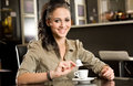 Beautiful young brunette and her coffee. Stock Photography