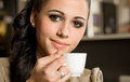 Beautiful young brunette and her coffee. Royalty Free Stock Images