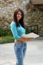 Beautiful Young Brunette with Notebook (3) Royalty Free Stock Photos