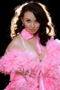 Beautiful young brunette in pink dancing dress Royalty Free Stock Photo