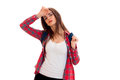 Beautiful young brunette students teenager in stylish clothes and backpack on her shoulders posing isolated on white Royalty Free Stock Photo