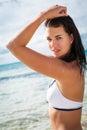 Beautiful young brunette woman in bikini sea ocean sunbathing Royalty Free Stock Images