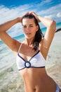 Beautiful young brunette woman in bikini sea ocean sunbathing Stock Photo