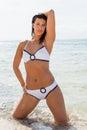 Beautiful young brunette woman in bikini sea ocean sunbathing Royalty Free Stock Image