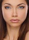 Beautiful young brunette woman with blue eyes Stock Image