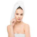 Beautiful young brunette woman with clean face and towel on her head. Isolated. Royalty Free Stock Photo