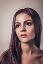 Beautiful young brunette woman glamour portrait Close up face Long hair Royalty Free Stock Photo