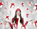 Beautiful young brunette woman with many gifts christmas portr on silver background portrait Royalty Free Stock Photo