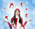 Beautiful young brunette woman with many gifts christmas portr on winter background portrait Stock Photos