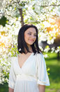 Beautiful young brunette woman in a spring park laughing Royalty Free Stock Photo