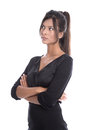 Beautiful young business woman in a black dress isolated businesswoman outfit sceptical and pessimistic Royalty Free Stock Image