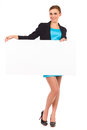 Beautiful young business woman with blank board full length studio shot isolated on white Stock Images