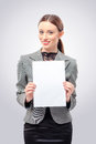 Beautiful young business woman holding blank card Royalty Free Stock Photo