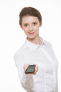 Beautiful young business woman holding mobile phone white background Stock Photos