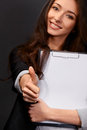 A beautiful young businesswoman giving you the thumbs up Royalty Free Stock Photo