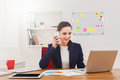 Beautiful young businesswoman making a call by mobile phone Royalty Free Stock Photo