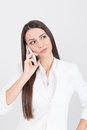 Beautiful young businesswoman speaking on the phone caucasian looking up business and technology white background Stock Images