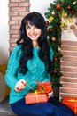 Beautiful young caucasian woman sitting in a Christmas interior, Royalty Free Stock Photo
