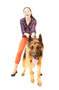 Beautiful young cheerful woman holds on a lead German Shepherd Royalty Free Stock Photo