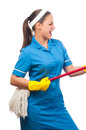Beautiful young cleaning lady singing Stock Photo
