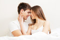 Beautiful young couple in bed Royalty Free Stock Images