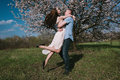 Beautiful young couple dancing and having fun on blue sky background Royalty Free Stock Photo