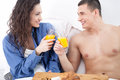 Beautiful young couple having breakfast in bed toast with orange juice Royalty Free Stock Photo