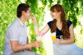 Beautiful Young Couple Having Fun. Picnic in Countryside. Happy Royalty Free Stock Photo