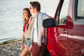 Young couple with car at riverside Royalty Free Stock Photo