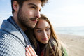 Beautiful young couple in love in a cold winter on the beach. Royalty Free Stock Photo
