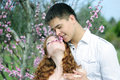 Beautiful young couple in love among the flowering trees one of pink Stock Photography