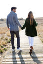 Beautiful young couple in love walking in a cold winter on the b Royalty Free Stock Photo