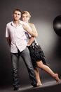 Beautiful young couple posing in studio Stock Images
