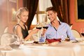 Beautiful young couple in restaurant with glasses of wine Royalty Free Stock Photography