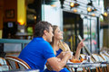 Beautiful young dating couple in Parisian cafe Royalty Free Stock Photo
