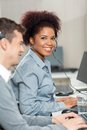 Beautiful young employee working in call center portrait of with male colleague Royalty Free Stock Image