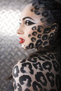 Beautiful young european model in cat make up and bodyart close portrait of Royalty Free Stock Photography