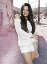 Beautiful young exotic asian woman standing outside in rustic america desert town Royalty Free Stock Photos